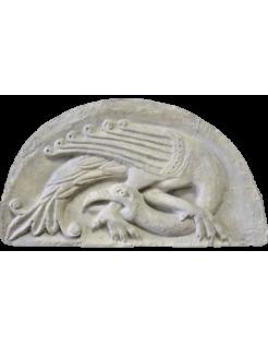 Pájaro quimérico mordiéndose la pata Poitiers - Siglo XII