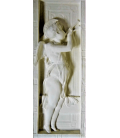 Bas relief of angel playing the double flute