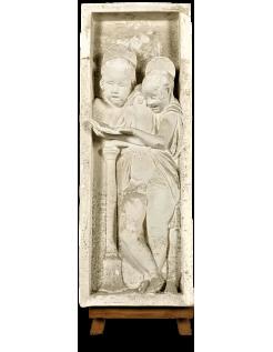 Bas relief of angels singing Bible verses